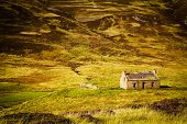 stock photo of abandoned house  - Little abandoned stone house in a middle of a mountain in the Cairngorms - JPG