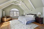image of master bedroom  - Master bedroom with ceiling beams and large window - JPG