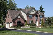 pic of front-entry  - Brick home in suburbs with arched entry - JPG