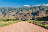 stock photo of shan  - Wide country road in Tien Shan mountains - JPG