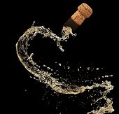 picture of squirt  - Cork of champagne in splash - JPG