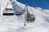 foto of ropeway  - Chairlift on a ski resort - JPG