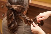 image of braids  - young woman at hairdresser making braid of hair - JPG