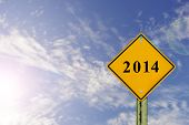 stock photo of benchmarking  - Road sign to 2014 with blue sky backgroundhappy new year 2014 - JPG