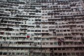 Overcrowded residential building in Hong Kong poster