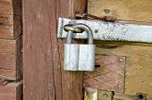 Old Padlock On Wooden Farm Barn Door
