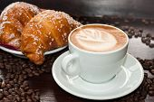 foto of croissant  - hot Cappuccino and croissant with coffee beans - JPG