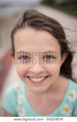 beautiful little girl with blue eyes and freckles, selective focus picture