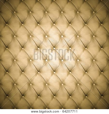 Abstract background texture of an old natural luxury, modern style leather with rhombs. Classic brown, black and dark pink grungy skin of retro wall, door, sofa or studio interior with metal buttons.
