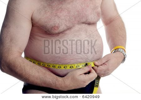 Over Weight Man Measuring His Stomach