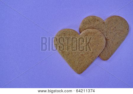 a couple of sweetheart shaped cookies