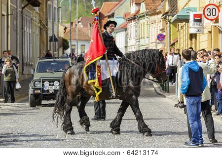 Horseman Holding Flag During Brasov Juni Parade