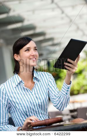 Businesswoman Paying Bill