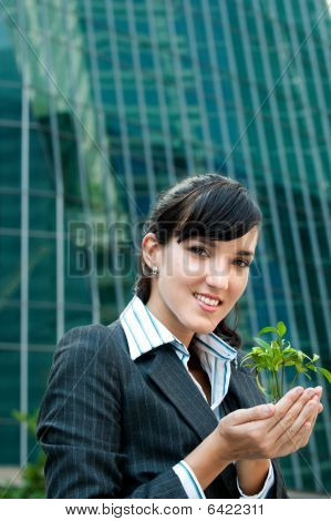 Businesswomen With Plant