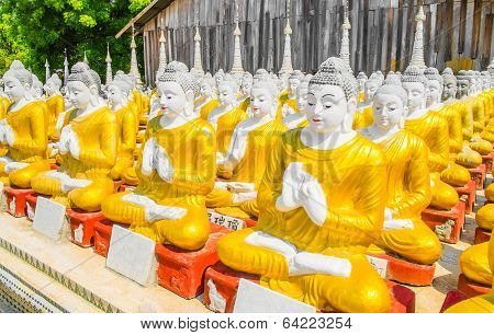 Row Of Buddha Statues At Myanmar Temple
