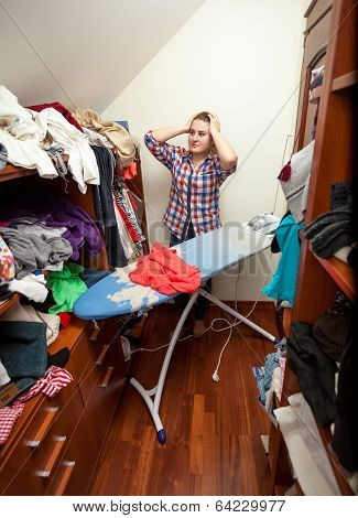 Housewife Having Headache Of Big Pile Of Not Ironed Clothes
