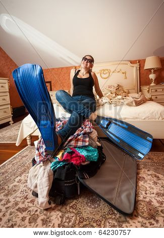 Woman In Flippers Holding Legs On Suitcase At Bedroom
