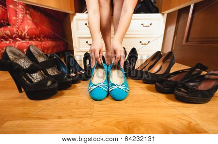 Woman Choosing Comfortable Flats Rather Than High Heels