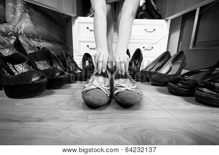 Woman Holding Ballet Flats Rather Then High Heels