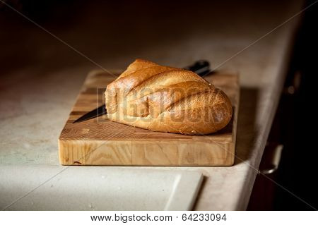 Photo Of Bread And Knife On Wooden Desk