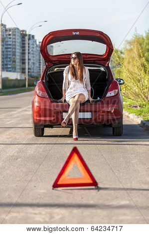 Helpless Woman Sitting Near Broken Red Car