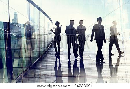 Silhouettes of Business People in Blurred Motion Walking