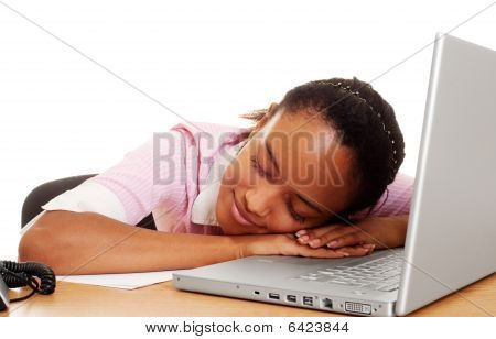 Pretty Student Sleeping On The Keyboard