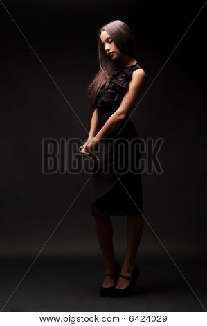 Sad Woman In Black Dress Looking Down