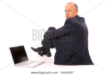 Serious Businessman Sitting On The Floor
