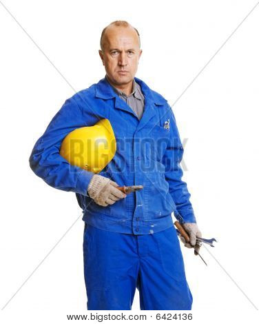 Serious Worker Holding His Hardhat And Different Tools