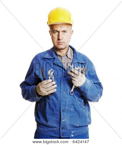 Serious Worker With Different Tools