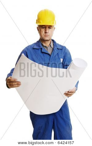 Serious Workman Looking To Blueprints