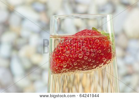 Fresh Strawberry On A Glass With Champagne