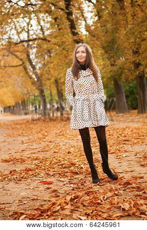 Young Woman Enjoying Beautiful Autumn Day