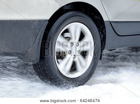 Dirty Car Wheel Stands On Winter Road
