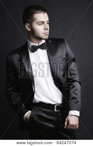 Handsome young man in shades of grey