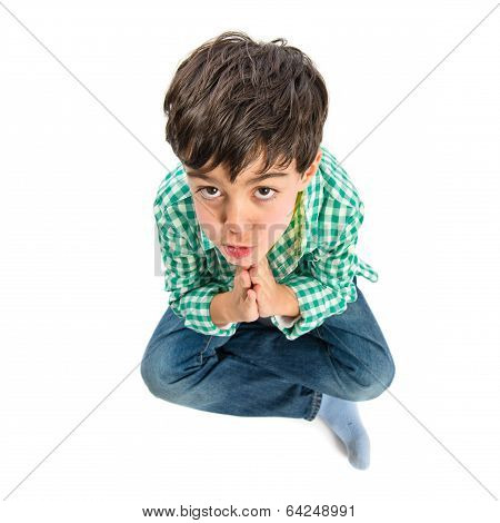 Brunette Boy Pleading Over Isolated White Background