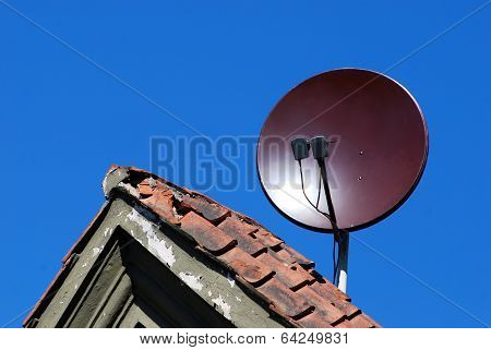 Satellite Dish Antenna On The Old Roof