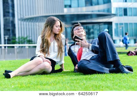 Successful Junior Executives Dynamics Laying Down On Green Grass