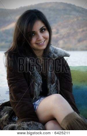 Vivant girl near lake