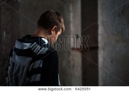 Problems Of Young Teenager Against Grunge Background With Skateboard And Shoulder Bag