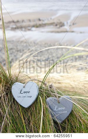 Two Love Hearts On Grassy Sand Dunes