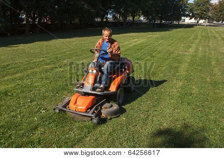 Ride-on lawn mower cutting grass.