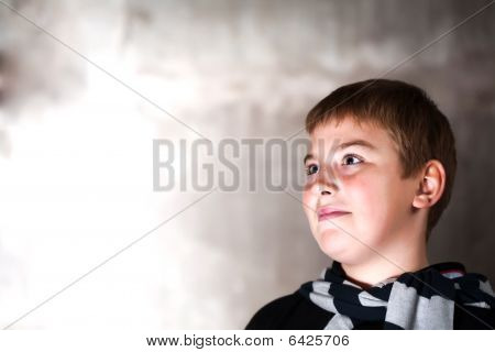 Handsome Young Boy Looking Up With Hope In His Eyes Copy Space