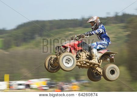 Quad Racer In Blue Is Jumping