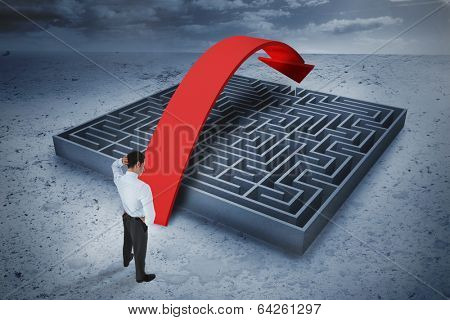 Thinking businessman scratching head against big maze with arrow under cloudy sky