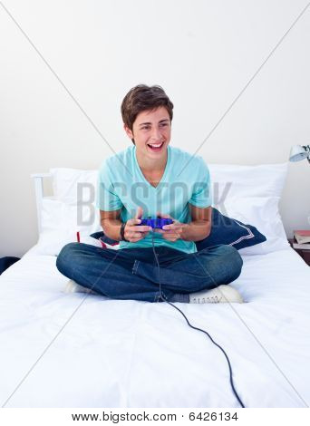 Teenager Playing Video Games On His Bed