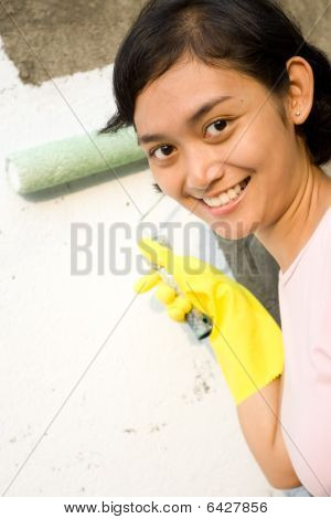 Happy Young Woman Painting