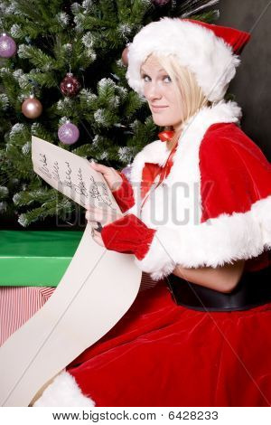Santa Helper With List By Tree