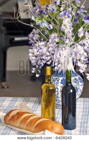 Table With Two Bottles Of Wine